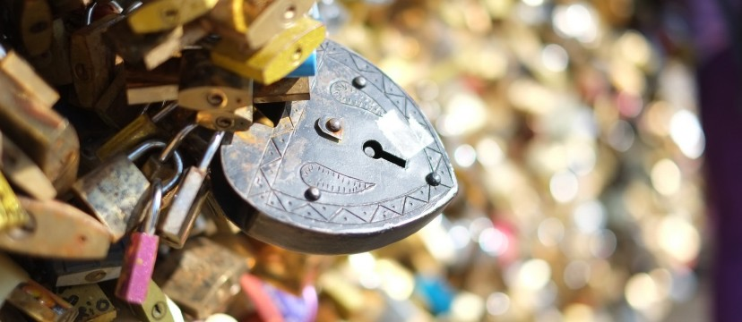 A heart shaped lock on Pont Des Arts in Paris