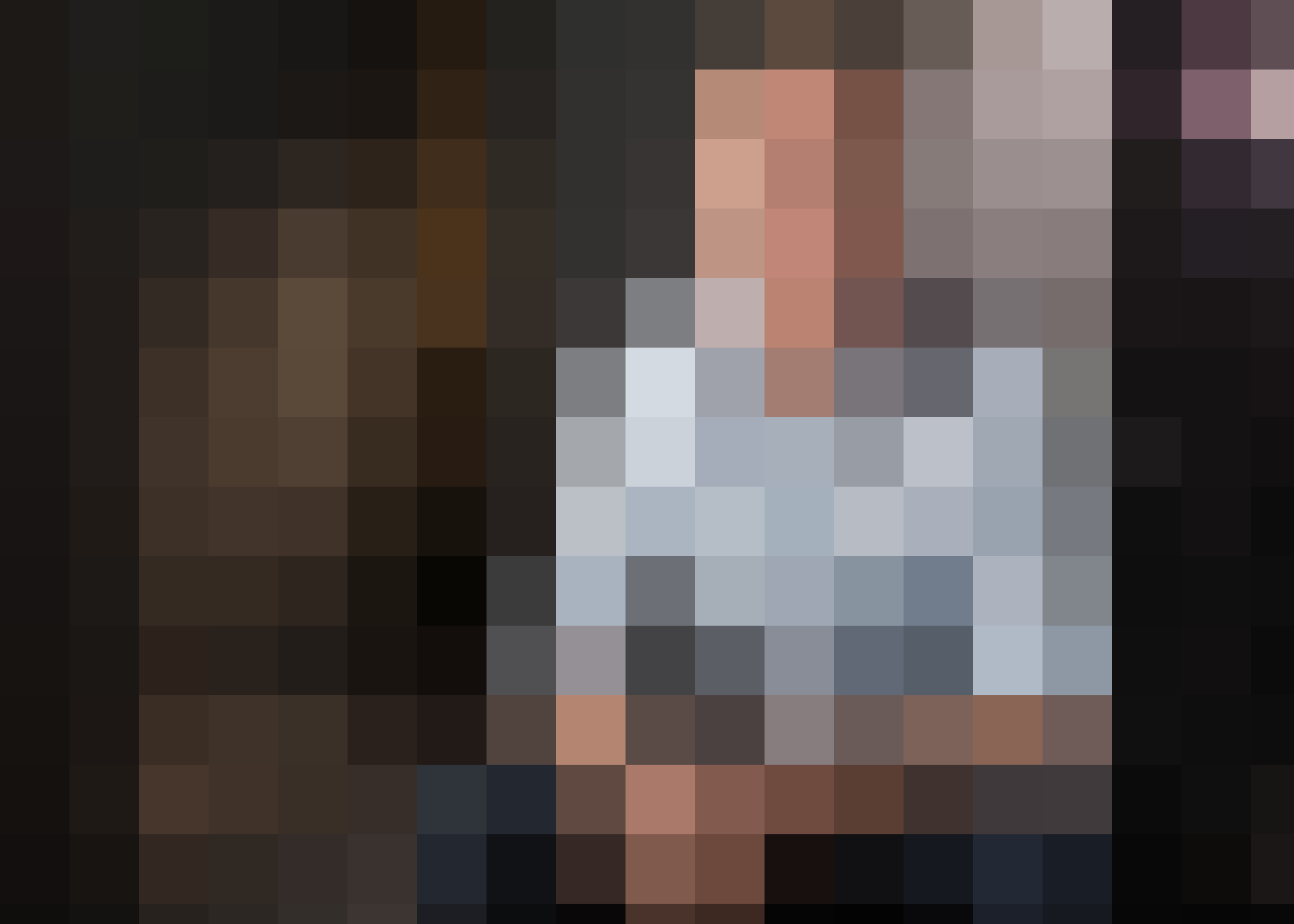 Extremely pixellated picture of a man in a blue shirt